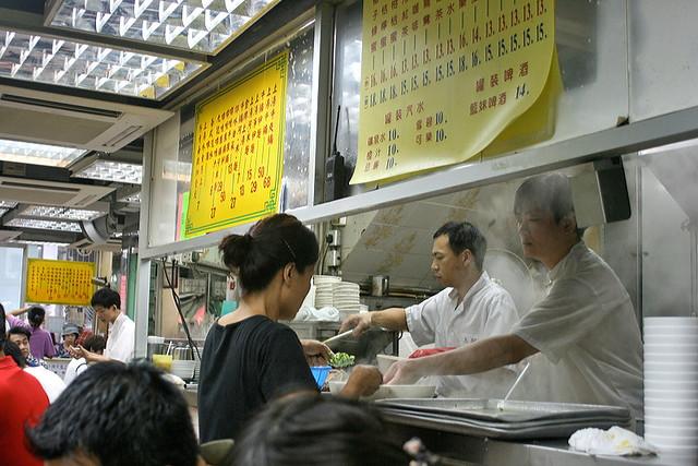 Busy, nonstop action in Kau Kee's kitchen