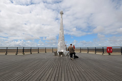 Southport - Frustratingly Non-Symmetrical (Andrew Hounslea) Tags: wood blue red sea england sky sculpture cloud brown beach lines clouds pier sand beige nikon photographer lifebelt unitedkingdom tripod perspective lancashire nikkor southport 1224 dx merseyside 1224dx d300s favouritemonth