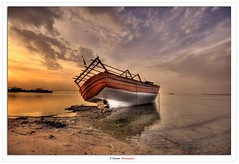 The Colorful Sunset Upon The Lonely Ship (Damon | Photography) Tags: blue sunset sea sky cloud sun seascape beach set clouds sunrise boats boat photo high nikon ship photographer dynamic 10 ships middleeast dramatic sigma east explore shore kuwait 20 middle range frontpage 1020 damon hdr q8 sigma1020mm d90 nikond90