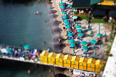 Tilt Shift (davidjthurgood) Tags: summer people italy blur color colour beach water umbrella boats high sand europe dynamic tan shift huts sorrento tilt range hdr 2010 tiltshift parasole beginer