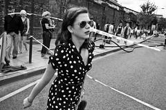 Polka dot (Gary Kinsman) Tags: london canon5d polka dot chalkfarmroad town candid street life police line shades fashion retro canon1740mmf4l bw blackwhite camdentown camden 2010 people person