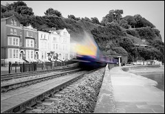 The Train brings a ray of light through Dawlish (Thrash Merchant) Tags: railroad blackandwhite bw blur train canon iso100 seaside diesel rail trains seawall devon f22 railways picnik firstgreatwestern ghosttrain mtu ghosting hst dawlish trix400 selectivecolouring highspeedtrain class43 intercity125 firstgroup ic125 fgw eos450d powercar kennawaytunnel firsttrains dawlishseawall firstgreatwesternhst fgwhst