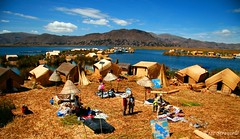 Uros islands, Lake Titicaca  Peru (kees straver (will be back online soon friends)) Tags: travel blue sunset summer vacation lake holiday mountains reflection tree green beach peru uros urosislands laketiticaca titicaca nature water silhouette landscape lago island boat pond paradise waves straw huts solarpanels puno strow livingonthewater keesstraver