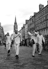 Fringe 2010 - the slow walking men in white 01 (byronv2) Tags: street blackandwhite bw man men monochrome festival scotland blackwhite edinburgh fringe royalmile performers oldtown 2010 edinburghfestivalfringe