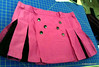 Hot pink mini with black inset pleats