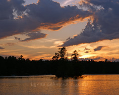 Evening Enchantment (Lynda Lehmann) Tags: light sunset sky lake inspiration color texture nature water beauty clouds reflections landscape outdoors island intense solitude peace maine scenic tranquility serene drama inspiring meditative photocontesttnc11 dailynaturetnc11