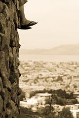 Still Waiting (wong_jordan) Tags: sf sanfrancisco blackandwhite bw feet blackwhite cityscape sightseeing aerialview tourist aerial twinpeaks bayarea rockwall cityview citybythebay viewfromthesky twinpeakslookout danglingfeet touristyspot highlocation