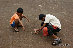 The marble players of Thane (Raju Bist) Tags: india playing boys maharashtra marbles thane