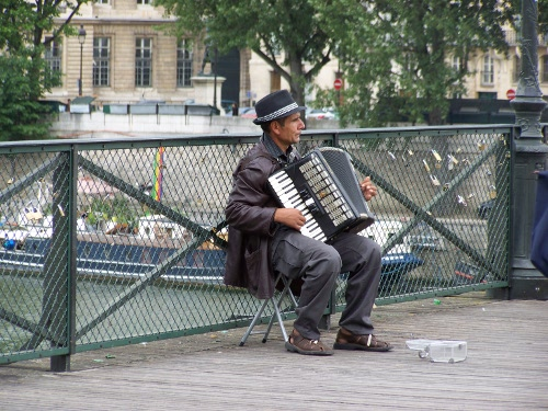 Accordion player on a bridge in Paris