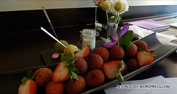 Complementary fruits, macarons and other dessert items from the hotel