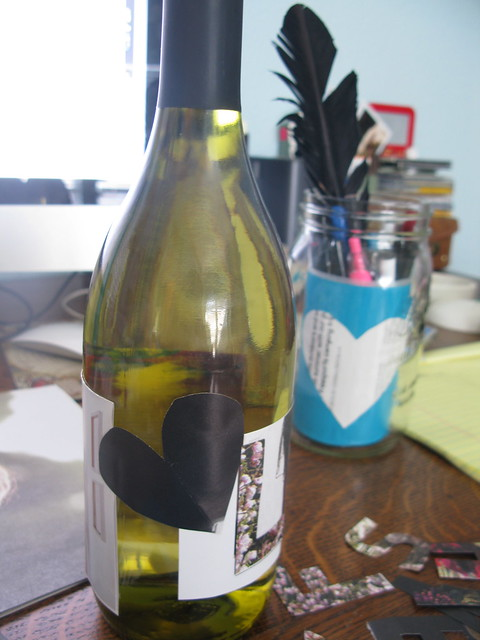 cut out magazine clippings and tape to bottle.