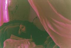 (keyana tea) Tags: pink film girl reading book bed room grain sheets pillows canonae1 expired unedited keyana