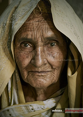 Age wrinkles the body. Quitting wrinkles the soul. (Muhammad Fahad Raza) Tags: street old light portrait woman photography eyes lowlight expression low streetphotography streetportrait oldwoman features punjab wri