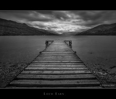 Loch Earn Jetty (Kit Downey) Tags: uk longexposure summer blackandwhite bw water clouds canon landscape mono coast scotland kiss jetty perthshire scottish perth crieff x4 stormclouds 2010 lochearn ndfilter stfillans scottishlandscape neutraldensityfilter scottishloch ndx1000 scottishwater tokina1116mmf28 kitdowney canon550d rebelt2i