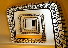 Spiral staircase (5ERG10) Tags: light shadow mer holiday black france sergio june yellow architecture stairs spiral hotel seaside nikon europa cotedazur riviera carlton mare cannes weekend steps stairwell stairway lookingup giallo staircase handrail provence railing nikkor 18200 nero architettura squared intercontinental sud spirale tromba 2010 provenza albergo croisette d300 ringhiera helical amiti 5erg10
