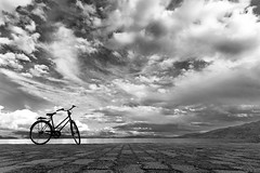 (Nick-K (Nikos Koutoulas)) Tags: bw lake bicycle silhouette clouds nikon albania f4 vr 1635mm   pogradec  d700   gvr1
