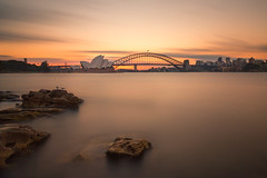 Sunset, Sydney Harbor (mclcbooks) Tags: sydneyoperahouse harborbridge sydney newsouthwales australia nsw harbor ocean bay water sunset evening sky clouds rocks longexposure le cityscape landscape