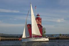 Sun Odyssey (DJ Wolfman) Tags: sailboats summer summerinmichigan bigred red blue sky sail holland hollandmi michigan michiganfavorites michiganlighthouses lake olympus olympuspenf penf zuiko 30mmf35 zd micro43