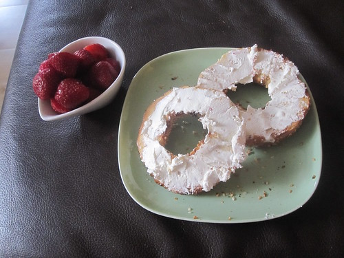 Bagel with cream cheese, strawberries