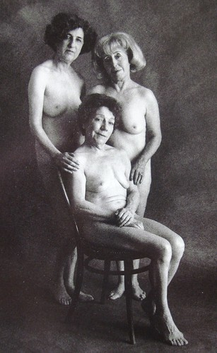 Three nude mature women and chair, 1969