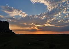 Sunset behind Lindisfarne Castle ( Marlene ) Tags: blue sunset orange castle silhouette clouds landscape golden nikon view northumberland rays sheeps cloudscape holyisland lindisfarne lindisfarnecastle d5000
