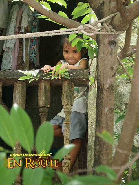 Kid at the Window behind the tree in Sabtang