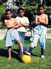 3 Stooges (Neo Rantissi [extremely busy!]) Tags: shirtless portrait people 3 alexandria kids 35mm children football nikon soccer young egyptian budak worldcup bola nikkor stooges muda kecil sepak d40 mesir kanakkanak zainal iskandariah takpakaibaju f18g neorantissi neosphotography