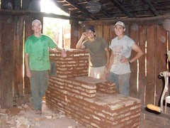 Taft Franklin, left, and two fellow Peace Corps volunteers stand next to a completed oven built in one of the homes in Paraguay. (Submitted photo)