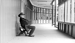 The Last Call (Sherlock77 (James)) Tags: people man calgary bench hallway cowboyhat calgarystampede