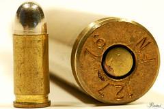 I for Inscription (Rami ) Tags: macro writing gold for big nikon top side small bottom shell powder case stamp numbers letter primer bullets ammunition inscription cartridge 105mm 50cal d80 i