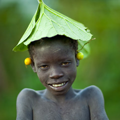 Shy surma boy in Turgit - Ethiopia (Eric Lafforgue) Tags: boy plant fruit kid child artistic culture shy tribal ornament tribes bodypainting tradition tribe ethnic rite enfant tribo adornment pigments ethnology tribu omo eastafrica thiopien garcon etiopia ethiopie etiopa 3651  etiopija ethnie ethiopi  etiopien etipia  etiyopya  nomadicpeople adorment      tulgit    peoplesoftheomovalley hatchapeaupeoplesoftheomovalley