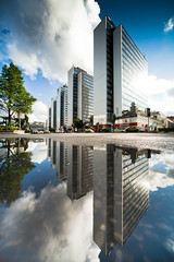 Lake Sveavgen II (Hannes R) Tags: street city sky cloud lake reflection building water rain clouds skyscraper buildings reflections puddle mirror town skyscrapers sweden stockholm htorget sveavgen htorgsskraporna