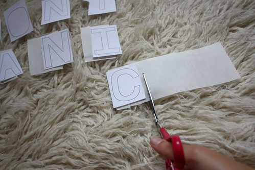 Step 1: Cut Wonder Under to Size of Paper Letters
