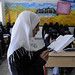 Students read in class at the Shaheed Mohamed Motaher Zaid School