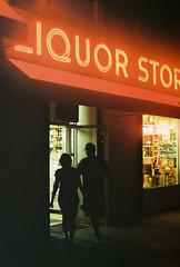 a spirited visit (~RichArtpix~) Tags: nyc nightphotography urban night neon manhattan drinking couples spirits liquor alcohol upperwestside liquorstore vices