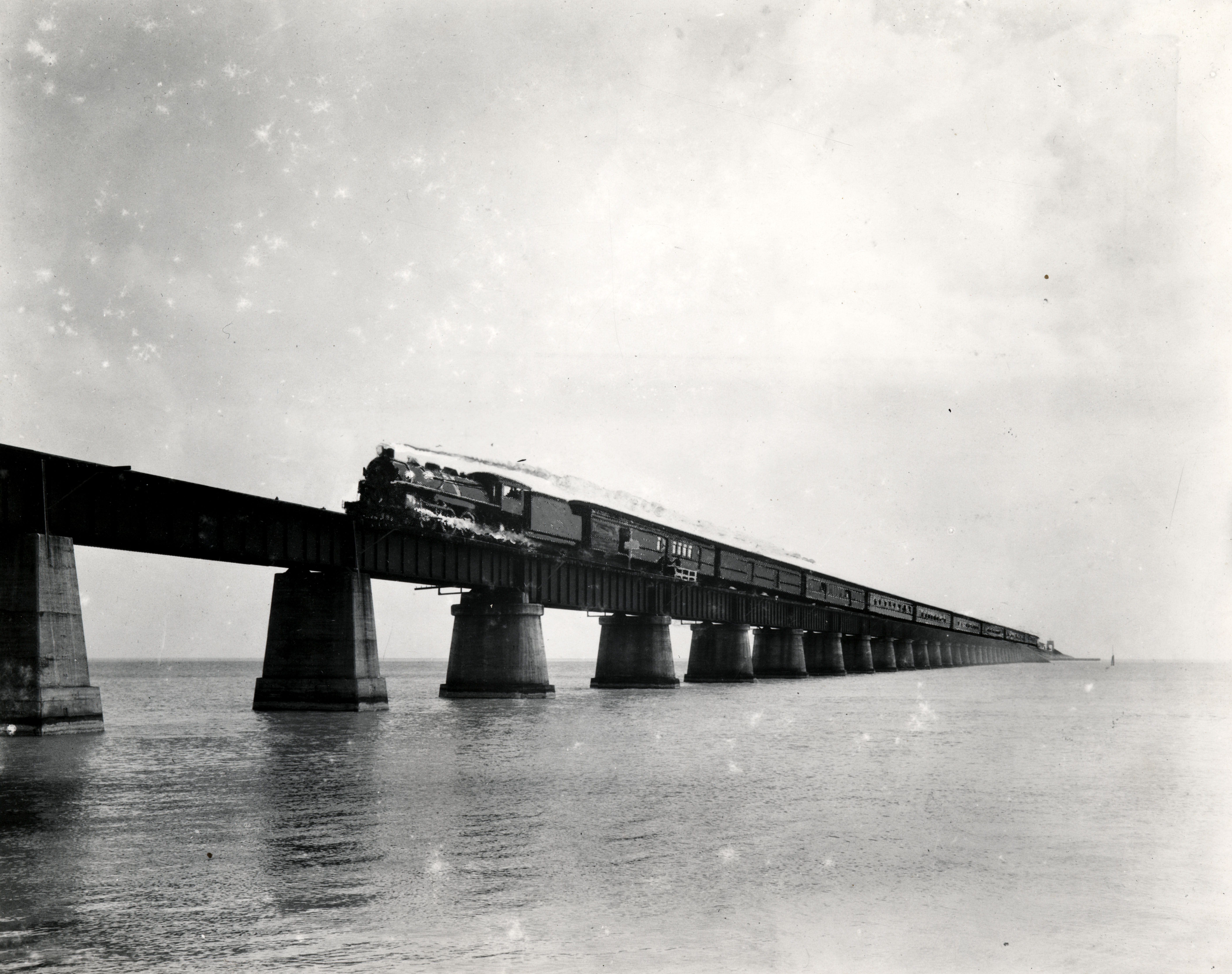 Florida East Coast Railway, Key West Extension. Train on the Seven Mile Bridge. Gift of Ramon Davis. Florida Keys Public Library.