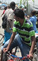 Buying Time (Legin_2009) Tags: road street man male men guy bike bicycle shirt asian ride market candid indian guys jeans riding jersey males caribbean poloshirt polo männer hombres mec southasian люди mecs 男子 gason אנשים الرجال पुरुषों 男子hommes 男性homens