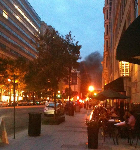 Huge smoke cloud in the distance in front of the Willard Hotel in DC