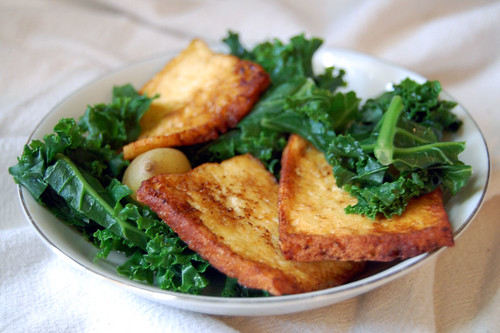 crispy fried tofu with kale and potatoes