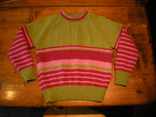 Green jumper with pink stripes