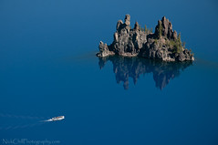 The Boat and The Phantom Ship, Crater Lake (Nick Chill Photography) Tags: blue oregon island photography lava nikon image stock phantomship tourboat craterlakenationalpark volcanicdike d300s nickchill deepbluelake
