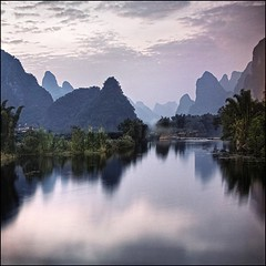 purper mountains (biancavanderwerf) Tags: china travel sunset mountains reflection square lila explore bianca karst frontpage longshutter purper idream earthasia ctrippic