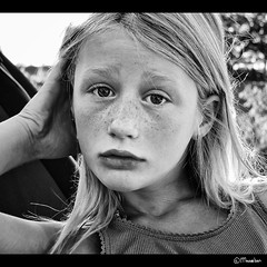 My daughter Liselot (Pjotre7 (www.maartenvandevoort.nl)) Tags: light portrait bw sun white black art netherlands girl dutch face model eyes moody child expression sony daughter lips explore story blond expressive freckles emotional ogen dochter 2010 melancholic zw liselot youngmodel explored sproeten hx1 sonyhx1 pjotre7