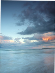 Druridge Bay (Michael Brewis (Northumbrian Blue)) Tags: lighting uk longexposure blue light sunset sea summer england sky cloud seascape blur colour beach water clouds landscape geotagged evening bay coast landscapes waves tide shoreline wave olympus northumberland shore northumbria northsea coastline incomingtide druridge cokinfilter northeastengland druridgebay e620 olympuse620