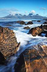 The Isle of Rum from Eigg (freeskiing) Tags: longexposure blue sea sun beach clouds sunrise bay august explore eigg isleofrum isleofeigg ainshval laig highlandsofscotland hallival soundofrum rumcuillin askival bayoflaig ndgrad09 benthorburn