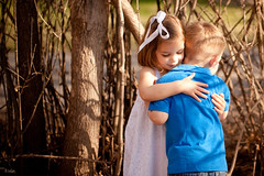 The Hug (Rebecca812) Tags: family trees portrait sunlight cute love beautiful kids canon children outside twins hug shadows sweet sister brother innocent daughter son security kawaii ribbon fraternal eyesclosed barebranches brownhair whitedress blondhair 5dmarkii familygetty2010 rebecca812