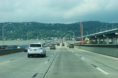 WESTBOUND OVER THE OLD TAPPEN ZEE BRIDGE IN JULY 2017 (richie 59) Tags: newyorkstate newyork dividedhighway unitedstates weekend trees traffic autos motorvehicles vehicles bridge saturday interstatehighway cars rocklandcountyny richie59 rocklandcounty hudsonriver america outside trucks summer newyorkstatethruway tappanzeebridge interstate287 thruway nythruway southnyackny southnyack bridgework 2017 july12017 july2017 i287 townoforangetownny townoforangetown 2010s hudsonvalley nystate ny usa us downstatenewyork downstate downstateny highway freeway road 6lanehighway sixlanehighway 6lane sixlane oldbridge newbridge backend tailights hill bridgeconstruction river water obsolete wornout
