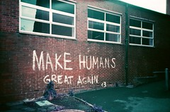 lc-a+ - make humans great again xpro (johnnytakespictures) Tags: lomo lomography lca lomochrome purple 35mm film analogue crossprocessed xpro photo photography leamington leamingtonspa saintpeters stpeters car park parking wall brick bricks street graffiti art paint words wording letters lettering makehumansgreatagain make humans great again heart 3 warwickshire