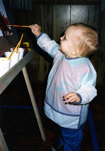 Will (1 1/2) at the easel in 1986.