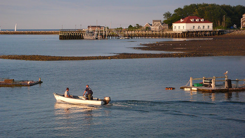A boat traverses Scituate Harbor.